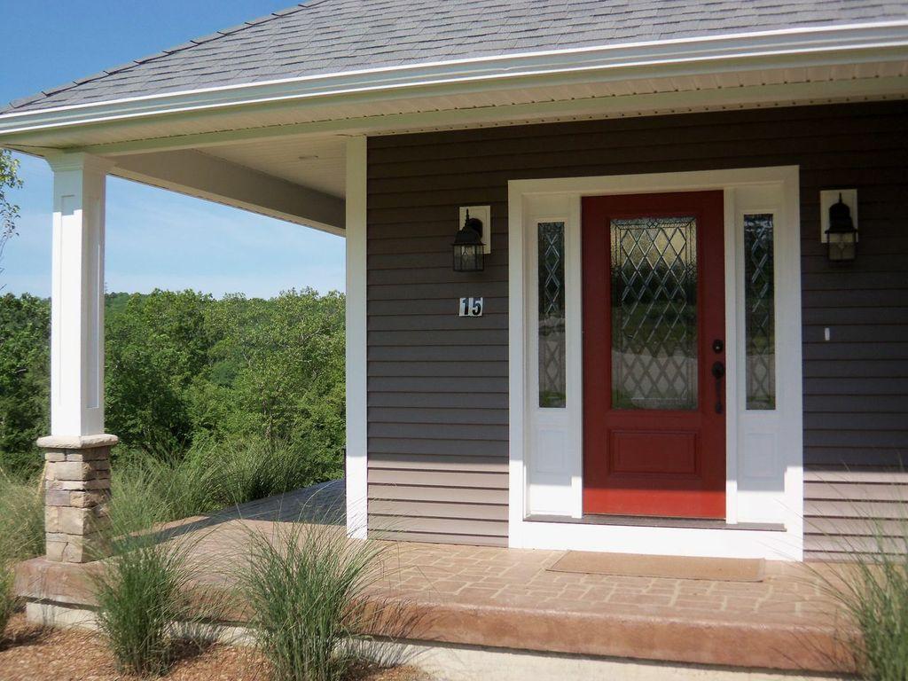 beautiful_door_between_wall_lamps_exterior_color_schemes_for_exterior_color_sche